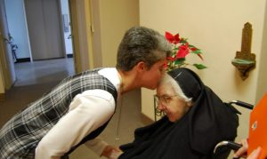 Sister Therese greets Sister Scholastica coming out of chapel