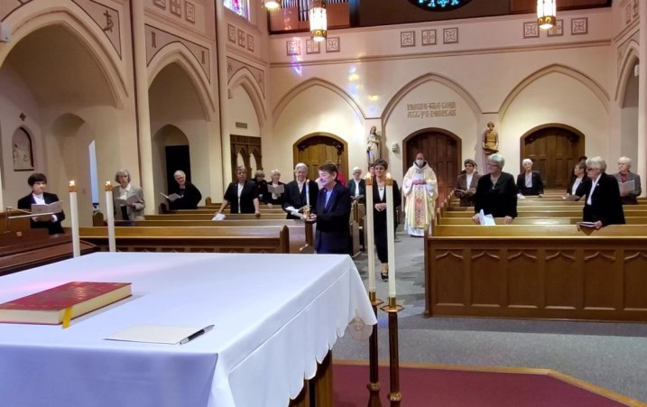 The Entrance Procession, with Sister Eileen and Jubilee Candle