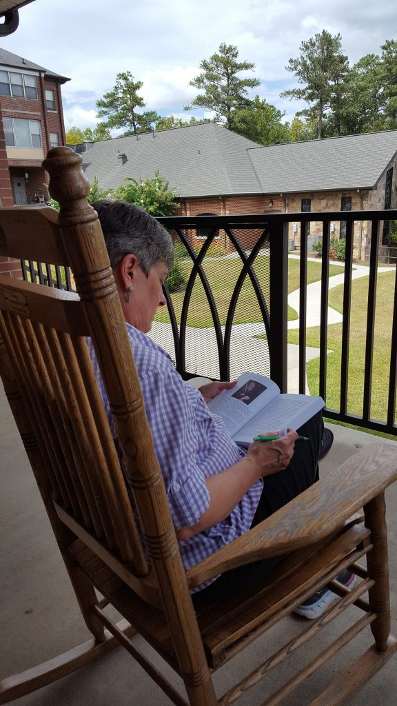 Guest reading on the dining room porch.