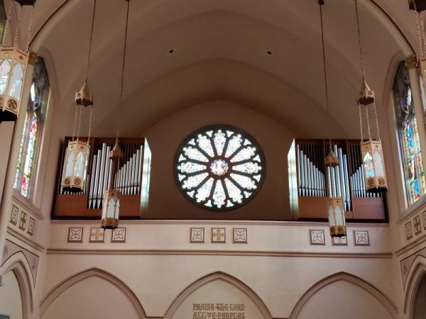 View of the choir loft, organ pipes and rose window