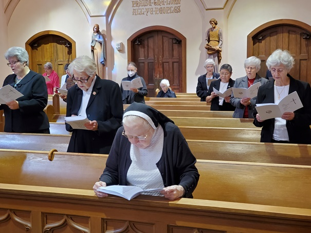 Singing the opening hymn, with social distancing