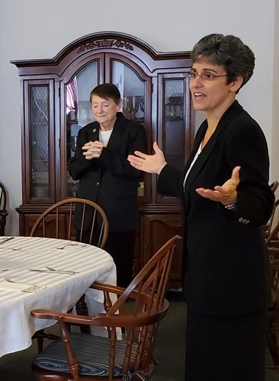 Sister Tonette invites the Sisters to pray before the Jubilee dinner