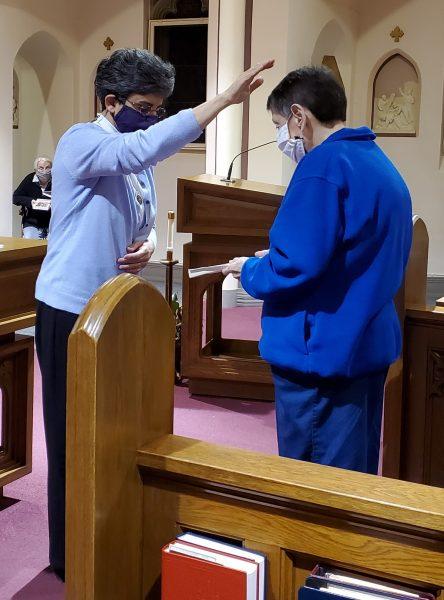 Sr. Tonette blesses Sr. Eileen and her Lenten reading