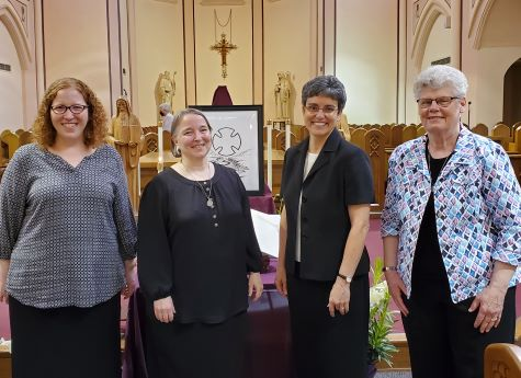 The Prioress-Elect and Prioress with the Election Presider and Discernment Facilitator