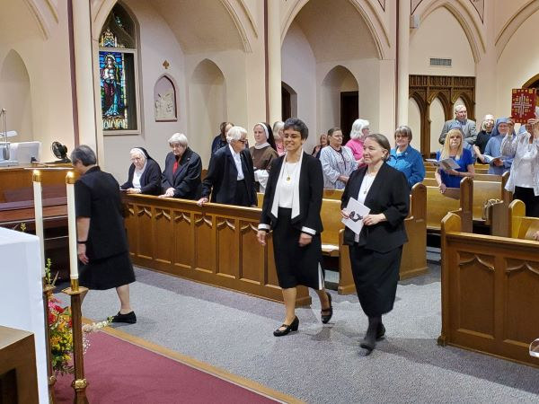 Sr. Tonette, outgoing Prioress, and Sr. Elisbeth, Prioress-Elect, enter the chapel
