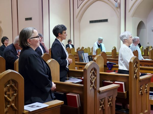 With the Rite of Installation completed, Sr. Elisabeth takes her place in the Prioress's choir stall.