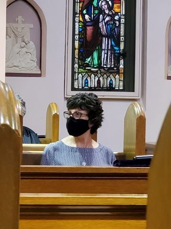 Margaret listens to a reading from scripture.