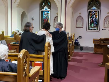 Sister Elisabeth and Sister Magdalena clothe Margaret with the white cuculla.