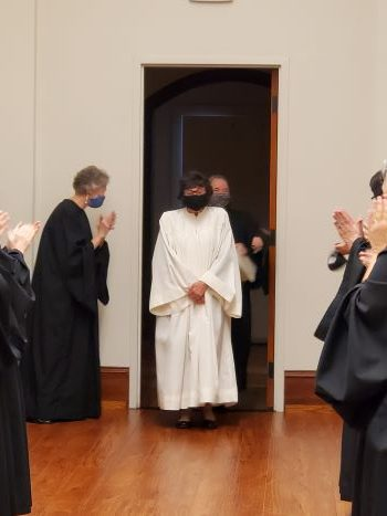 The newly-named Sister Margaret is welcomed by the community after Vespers.