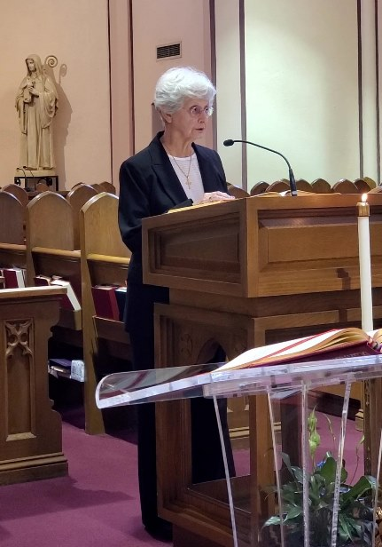 Sister Treva reads the First Reading