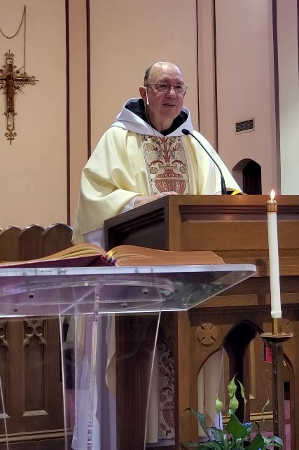 Fr. Joel, OSB, offers the homily