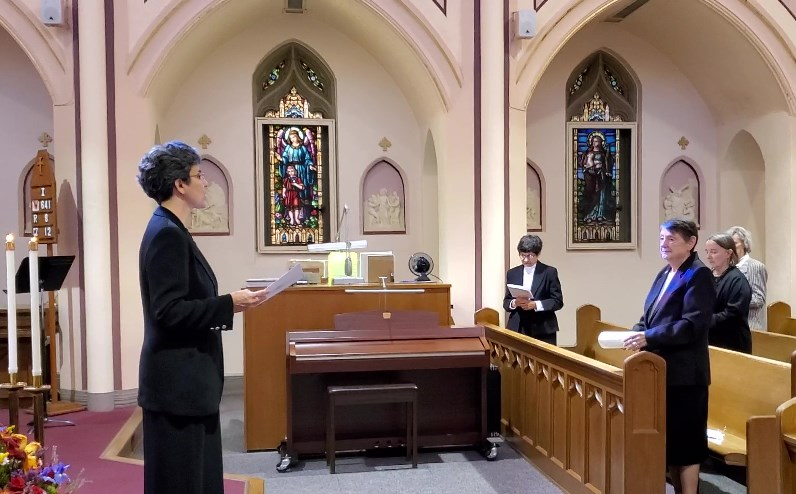 Sister Eileen listens to Sister Tonette during the Rite of Renewal of Monastic Profession