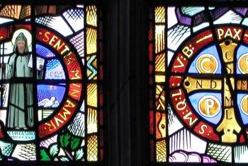 Benedictine medal in chapel clerestory window