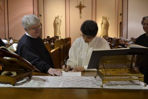 Sister Minona Anne signs her profession document