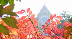 Fall leaves and monastery chapel