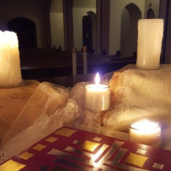 Candles representing the light of the saints on the Vigil of All Saints