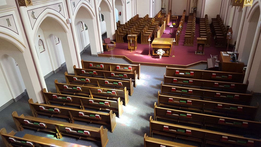 The choir stalls, in the east side of the chapel are where the Sisters pray the Liturgy of the Hours, while the pews are used for Mass. This is a traditional arrangement for monastic chapels.