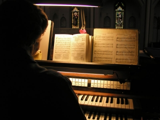 Sister Magdalena practices on the organ