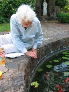 Sister Regina feeding the goldfish