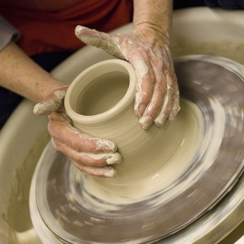 Sister Adrian at the pottery wheel