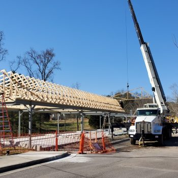 crane lifting trusses into place