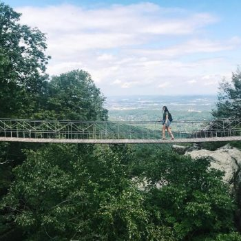 Woman crossing Rock City bridge